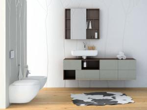 Nad umywalką szafka wisząca z przesuwnym lustrem z serii DOMINO Premium.